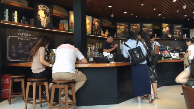 more chinese consumers have been influenced to drink coffee or drink more coffee so that the turnover in starbucks has increased by 6% and the same... - coffee drink stock videos and b-roll footage