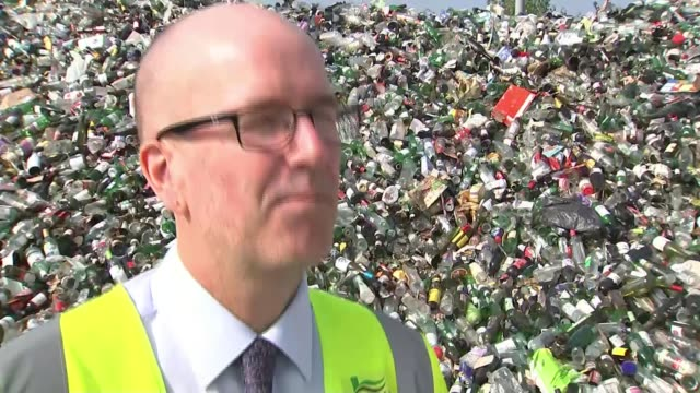 more councils plan to switch to monthly rubbish collections bottles emptied from vehicle at recycling centre reporter talking to andrew wilkinson... - vehicle scoop stock videos and b-roll footage