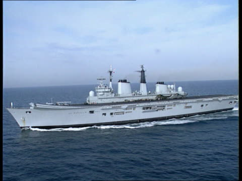 more defence cuts itn airv aircraft carrier along rosyth naval base airv base airv ditto - aircraft carrier stock videos and b-roll footage