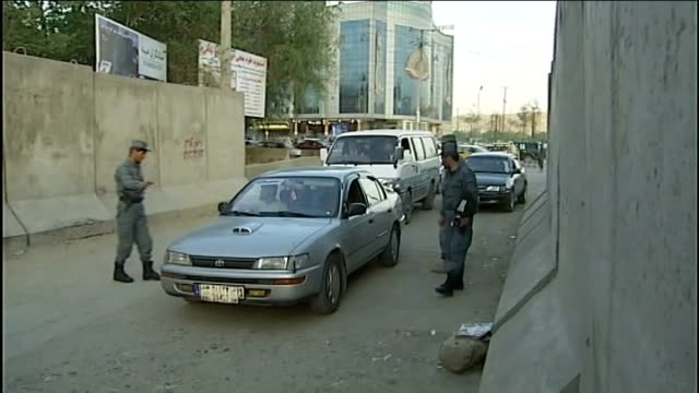 More details emerge on shooting of Osama bin Laden Afghan soldiers stopping traffic Rifle held by soldier as cars along at checkpoint Afghan men...