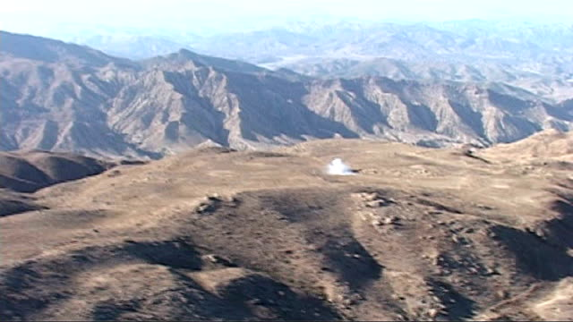More details emerge on shooting of Osama bin Laden AFGHANISTAN VIEW / AERIAL mountains along Afghanistan Pakistan border Soldier of the US 10th...