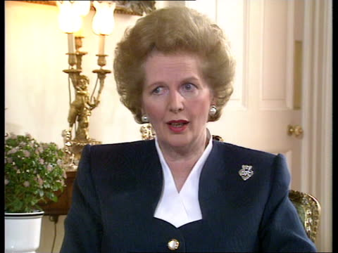 more families losing homes through possession; itn lib margaret thatcher interview sot abbey national electronic sign/int customer at counter: - home economics点の映像素材/bロール