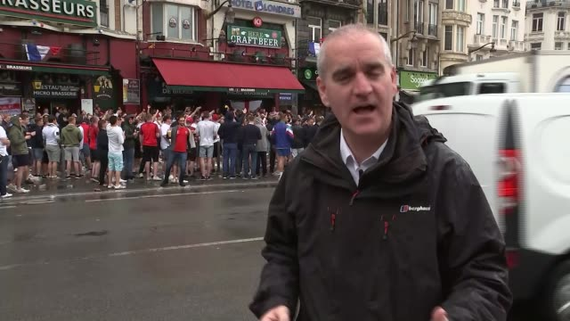 more fans arrested ahead of england v wales match day various of england fans along reporter to camera lens int police officer wearing headset police... - lens pas de calais stock videos & royalty-free footage