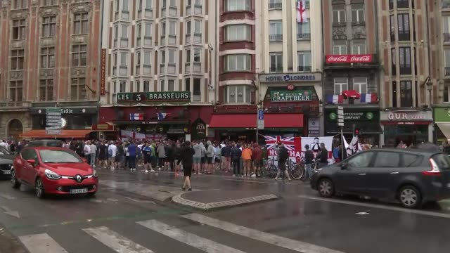 more fans arrested ahead of england v wales match france lille ext group of england fans chanting outside bar wide shot of fans outside bars england... - lille stock videos & royalty-free footage