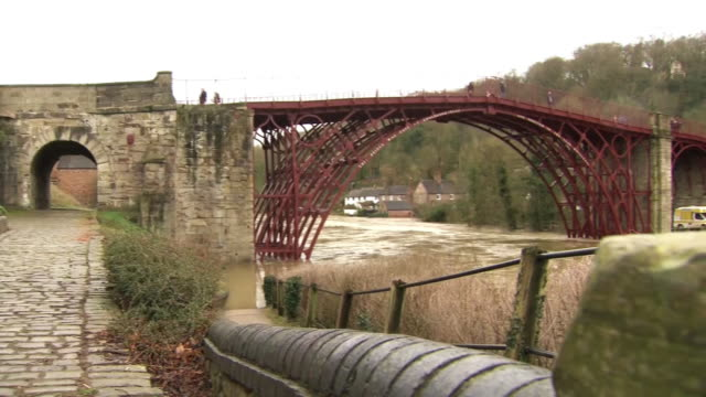 more heavy rain predicted to already flooded areas. shows: clean up operation after floods as items are thrown away, interview with flood victim... - ironbridge shropshire stock videos & royalty-free footage