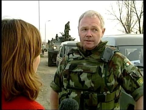 more nato troops arrive to help quell violence; itn ???: cms irish peacekeeping soldiers cms rear access door of armoured personnel carrier lowered... - major road bildbanksvideor och videomaterial från bakom kulisserna