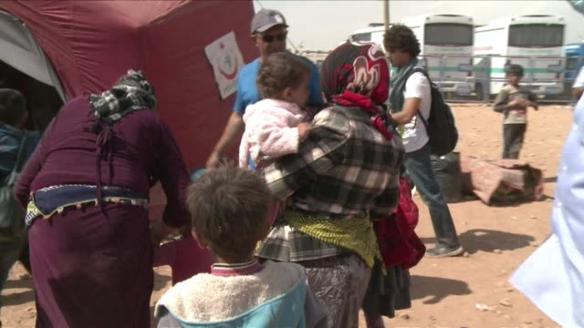 more refugees arrived in turkey on wednesday as the country struggles to accommodate the influx of almost 140000 kurds seeking sanctuary from islamic... - syria stock videos & royalty-free footage