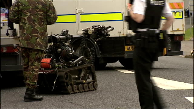 more Republican dissident bomb attacks NORTHERN IRELAND County Londonderry Tobermore EXT Remote controlled bomb disposal robot along to bomb at side...