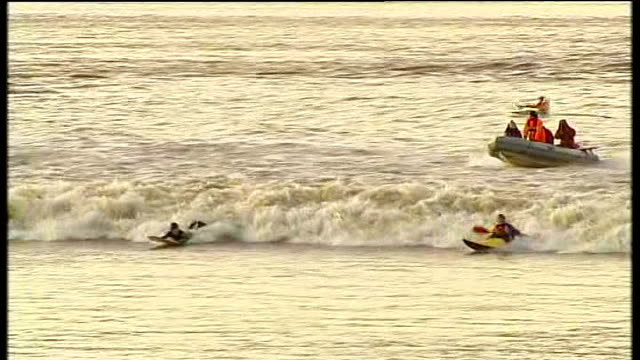 more storms and floods forecast for south west england gloucestershire broad oak various of surfers and kayakers along on large wave on river - gloucestershire stock videos and b-roll footage