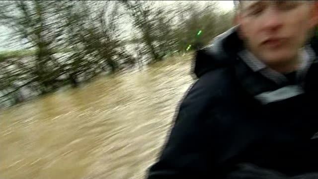 more stormy conditions and heavy rain in england and wales; england: somerset: ext boat along through flooded countryside to reach the village of... - extreme weather stock videos & royalty-free footage