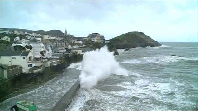 more stormy conditions and heavy rain in england and wales scotland ext police car along coastal road as waves break ashore whipped up by storm force... - aberystwyth stock videos & royalty-free footage
