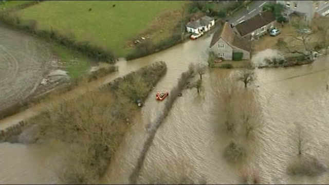 more stormy conditions and heavy rain in england and wales; somerset: int helicopter helicopter pilot flying over flooded countryside reporter... - cut video transition stock videos & royalty-free footage
