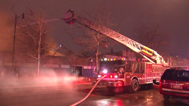 more than 100 firefighters were called the scene of a fire at an auto financing company on march 10 2014 in chicago illinois - cherry picker stock videos & royalty-free footage