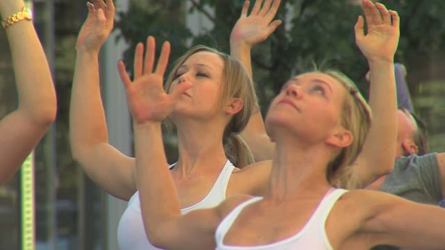More than 100 people doing yoga in Denver Colorado showing various poses Yoga and Fitness at Cherry Creek on September 09 2012 in Denver Colorado