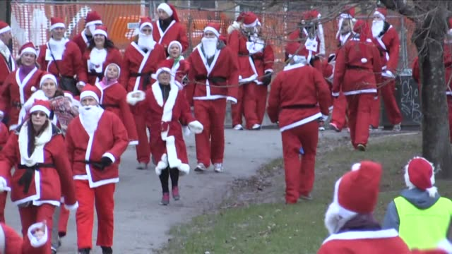 More than 1000 joggers dressed as Santa Claus in red suits boots and long white beards ran through the streets of Stockholm for charity on Sunday