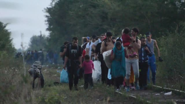 more than 1,000 migrants and refugees arrive in eu member hungary, the first of around 7,000 who found their gruelling journey to europe blocked when... - hungary stock videos & royalty-free footage