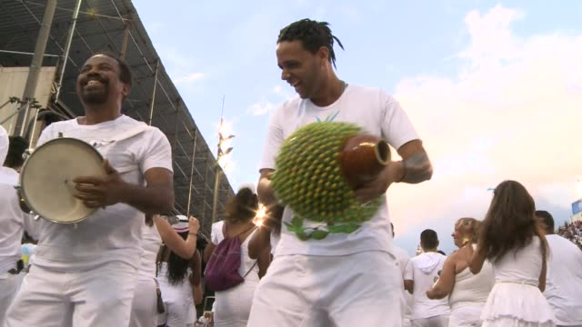 More than 1000 white clad Brazilians from Bahia state who follow the Afro Brazilian religion Candomble took part in a ceremony to purify Rios...