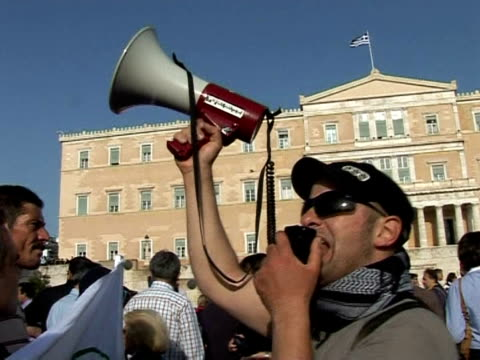 more than 10,000 people demonstrated peacefully thursday in athens as lawmakers voted on a drastic austerity package, a day after protests against... - legislator stock videos & royalty-free footage