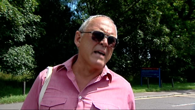 more than 20 nhs trusts in financial crisis; vox pops 'b' block hospital main entrance with people and cars parked in foreground hospital sign for... - b rolle stock-videos und b-roll-filmmaterial