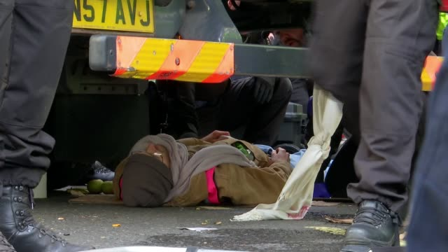 more than 200 arrested on second day of extinction rebellion protests in central london uk london westminster general views of extinction rebellion... - lying on front stock videos & royalty-free footage