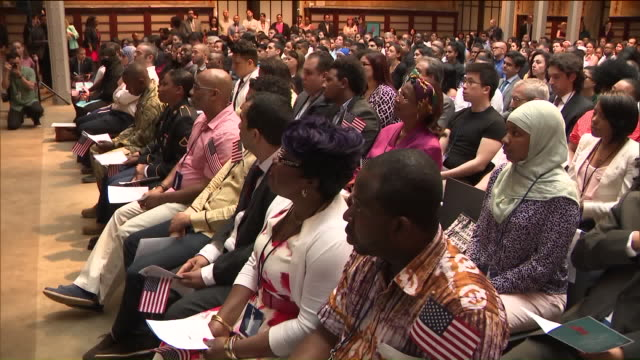 more than 200 immigrants became us citizens today. the naturalization ceremony was held at the public library on fifth ave. candidates from more than... - ceremony stock videos & royalty-free footage