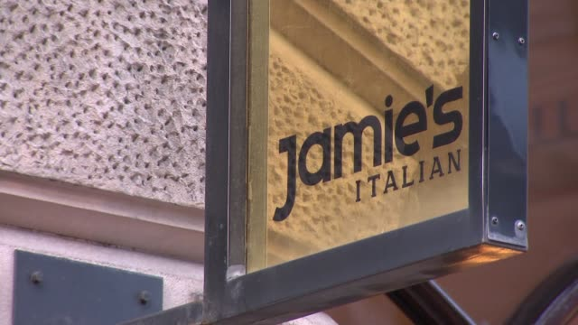 More than 200 jobs at risk as 12 sites of 'Jamie's Italian' to close ENGLAND London EXT Wide shot 'Jamie's Italian' entrance TILT 'Jamie's Italian'...