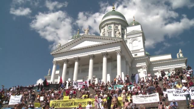 more than 2000 people protest in helsinki denouncing attacks on human rights press freedom and dissent as the city prepares to host an historic us... - diplomacy stock videos and b-roll footage