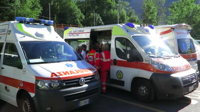 More than 30 tourists including three children who spent a dramatic night stranded in cable cars above the French Alps were brought to the ground...