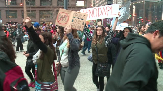 wgn more than 300 people were protesting a proposed pipeline being constructed across four states and near native american land on nov 12... - minority groups stock videos & royalty-free footage