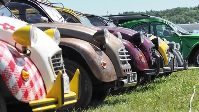 More than 3000 cars attend the annual Citroen 2CV gathering in central France where enthusiasts celebrate the very first popular French automobile...