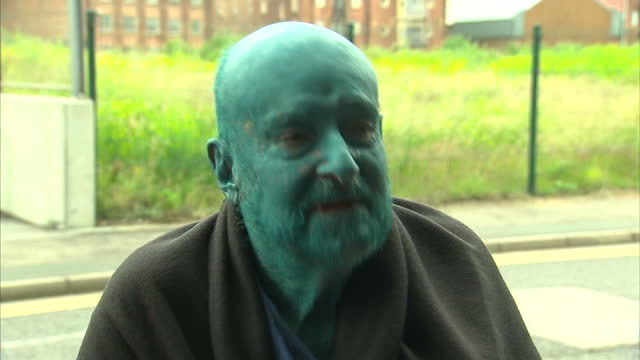 more than 3,000 people from 20 countries have stripped off and been painted blue as they took part in a mass human artwork in hull. gathering at... - swing bridge stock videos & royalty-free footage