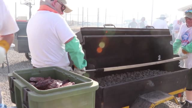 more than 40 volunteers from minnesota flew to camp arifjan kuwait to serve a steak barbeque to soldiers of the 34th red bull infantry division... - bbq stock videos & royalty-free footage