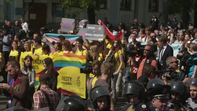 more than 700 gay rights activists march through central kiev prompting an unprecedented security operation in the ex soviet country where homophobia... - homophobia stock videos and b-roll footage