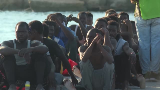 more than 90 migrants from sub-saharan africa who had left from libya are rescued by the italian coast guard in the mediterranean sea and brought to... - north africa stock videos & royalty-free footage