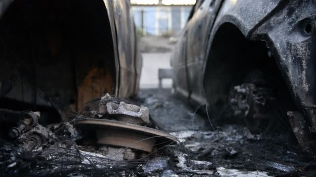 more than a dozen cars were torched and schools shops and a police station were set ablaze as riots swept through stockholms immigrant dominated... - dozen stock videos & royalty-free footage