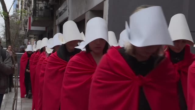 more than a hundred activists in favour of decriminalizing abortion in argentina dress as handmaids from margaret atwood's novel the handmaid's tale... - debate stock videos and b-roll footage