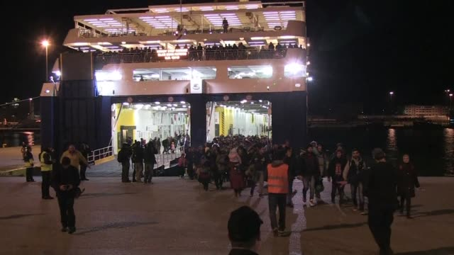 More than a thousand migrants arrived by ferry from the islands of Chios and Lesbos to the port of Piraeus in Athens on Monday