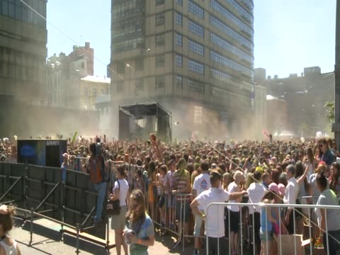 more than a thousand people attend the color festival held at saharova square in moscow, russia on july 13, 2014. people throw paint balls to each... - attending stock videos & royalty-free footage