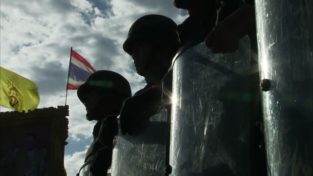 more than a thousand protestors confronted soldiers in bangkok today, despite a warning from the army to stay away. they were demonstrating against... - coup d'état stock videos & royalty-free footage