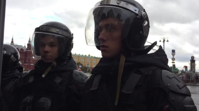 more than a thousand supporters of the jailed opposition leader alexei navalny rallied in rainy moscow on president vladimir putin's 65th birthday... - strongman stock videos & royalty-free footage