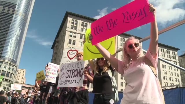 More than half a million people flood the streets of Los Angeles in one of the largest marches for women's rights following the election of Donald...