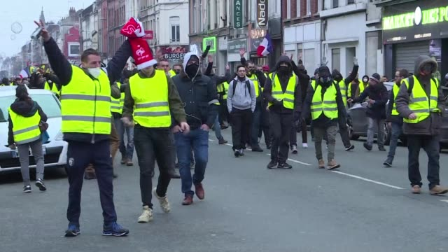 more than one thousand yellow vest protesters return to the streets in lille france with some confrontations with the police leading to 42 arrests... - lille stock videos & royalty-free footage