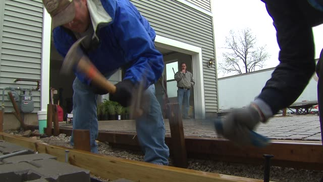 more than two dozen attorney's and personnel joined to help with phase two of the dupage habitat for humanity's prairie green development, a project... - dozen stock videos & royalty-free footage