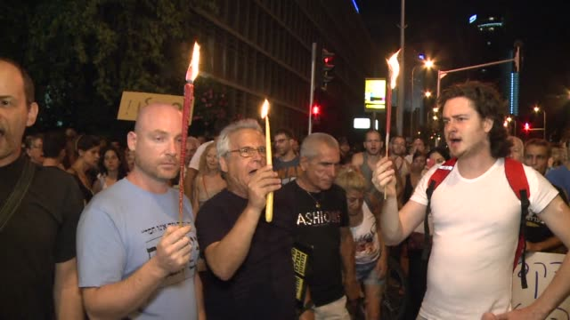 vídeos de stock, filmes e b-roll de more than two thousand israelis demonstrated on saturday night in tel aviv in memory of moshe silman an israeli who died after setting himself on... - autoimolação