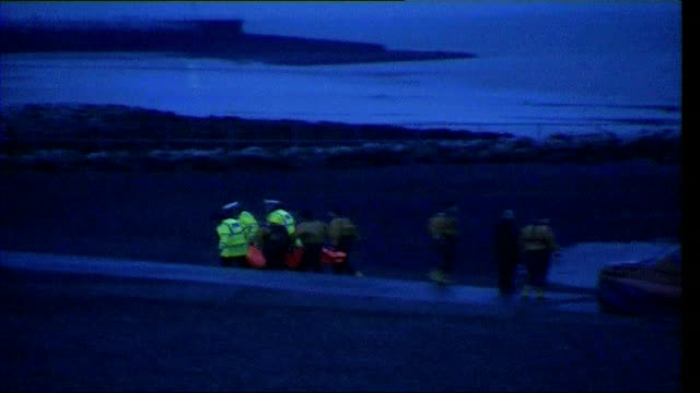 cockle banks reopen tx 622004 morecambe bay long shot of covered body on stretcher being carried from rescue boat across beach after group of chinese... - rising tide stock videos & royalty-free footage