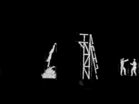 lancashire morecambe tracking shot through lights / gv ditto / gv morecambe lights / gv man dives off board / tracking shot through lights / ms rock... - mad hatter stock videos and b-roll footage
