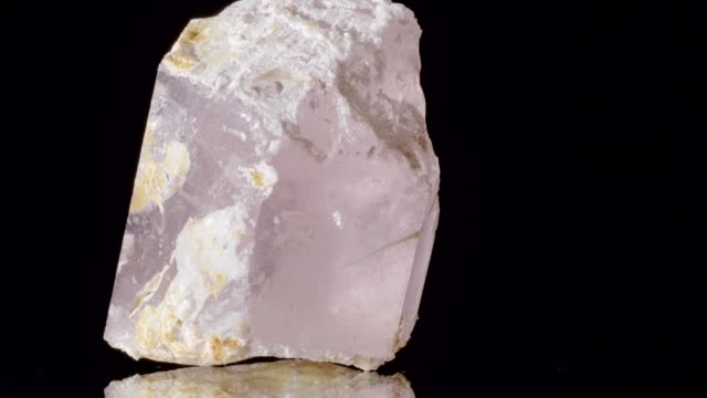 morganite on black background - quarzo video stock e b–roll