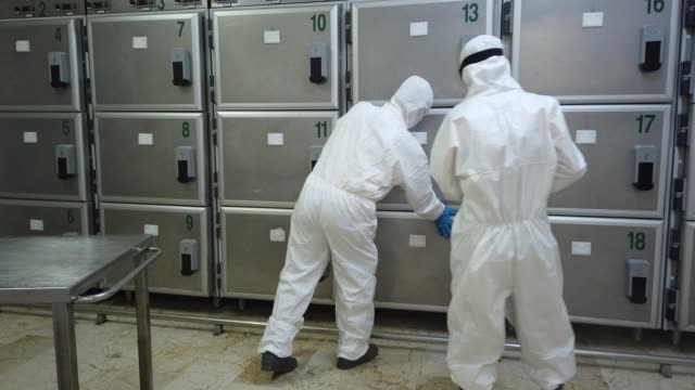 morgue worker wearing personal protective equipment disinfects a room at the zincirlikuyu morgue on may 15, 2020 in istanbul, turkey. with 16 million... - funeral stock videos & royalty-free footage