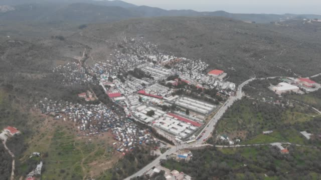 moria refugee and makeshift camp february 2020 4k video of moria refugee camp in lesvos island near moria village near mytilene town in greece aerial... - flüchtlingslager stock-videos und b-roll-filmmaterial