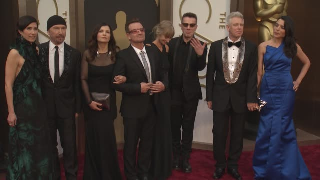 Morleigh Steinberg The Edge Alison Hewson Bono Ann Acheson Larry Mullen Jr Adam Clayton and Mariana Teixeira 86th Annual Academy Awards Arrivals at...
